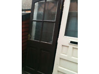 Exterior hardwood door with patterned glass panels