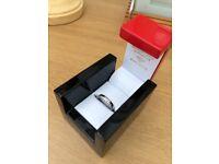 Platinum band 0.55 carat diamond ring