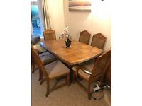 Stunning solid wood extendable dining table and 6 chairs