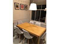 Solid extending dining table in great condition - priced for quick sale