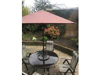Pagoda Patio set with 4 reclining chairs and adjustable parasol