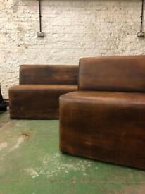 Two brown leather(?) benches. Perfect for bar/cafe.