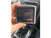 Tom tom sat nav, with in car charger.