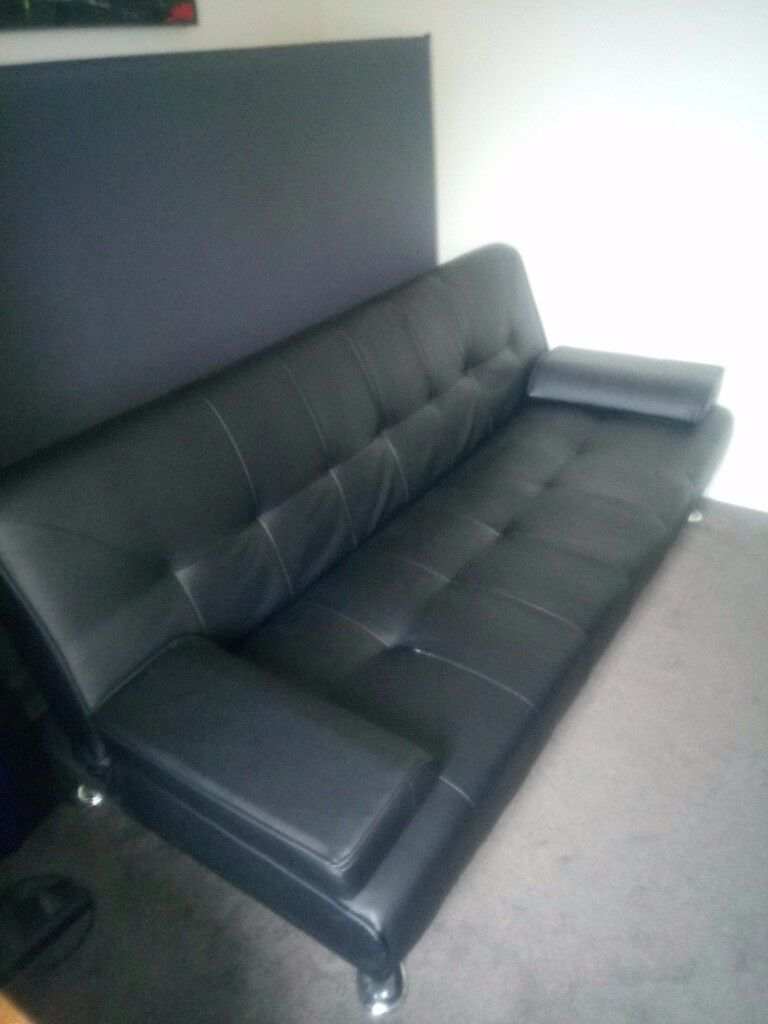 Faux-leather sofa-bed. Must go this weekend