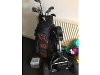 Golf clubs and bag and electric cart