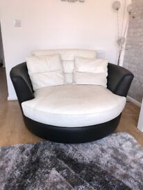 White and black leather Corner sofa, cuddler chair and foot stool. All from DFS