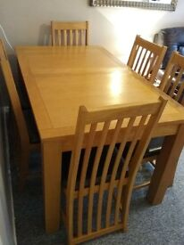Light oak extendable dining table and 6 chairs. very good condition, slight water mark on table £350