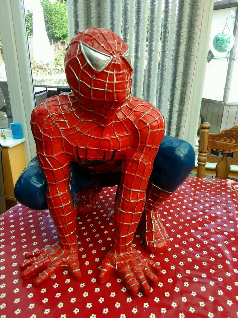 Spiderman statue and picture