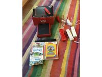 Wii mini with extra controller and games.