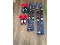 2 pairs of Salmon child skis different sizes and 2 pairs of Salmon ski boots all the same sizes.