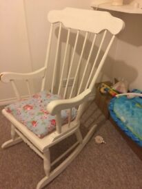 Lovely white rocking chair ideal for babies nursery