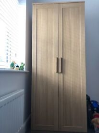 Wood effect wardrobe in excellent condition as only a year old bought from John Lewis