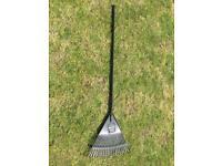 Brand new metal and plastic garden lawn rake