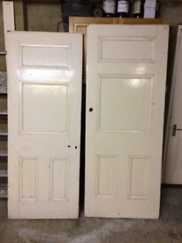 Two late Victorian solid pine panel doors, one with two ornate brass finger plates