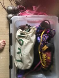 A variety of climbing gear including shoes, ropes, harnesses