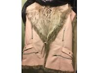 Pale pink leather gilet