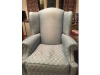 Large light blue wing back armchair. Very comfortable. Excellent condition