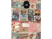 Nintendo ds lite with 8 games, carry case, charger and four game cases