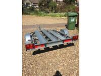 Trigano tipping motorbike trailer + ramp/spare wheel