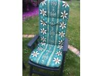 Four reclining garden chairs with cushions