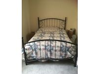 Cottage style double bed with ornate metal frame