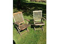 2 hardwood folding garden arm chairs £25 ono