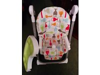 Cosatto height adjustable highchair with extra inset tray in the table.