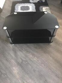 Black glass TV stand for sale.