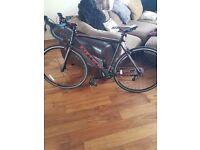 Carrera road bike good as new. Boardman helmet. Catseyes lights