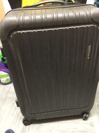 DELSEY VALAGUZZA black hard shell with 2 wheels and handle suitcase