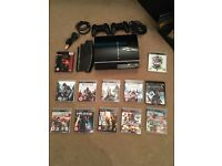 PS3 console with 12 games 2x controllers