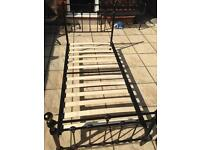 Black and gold single bed frame and mattress