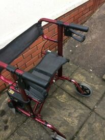 Mobility Walker - Red and Black, includes seat and storage compartments.