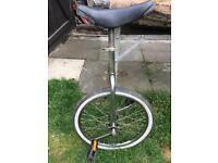 Uni-cycle with adjustable seat.