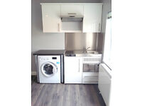 BRAND NEW LARGE STUDIO FLAT WITH PATIO - AVAILABLE NOW