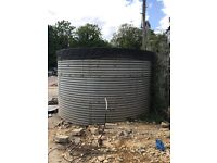Large water tank for irrigation and electric pump 2.4 m high and 3 m wide