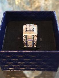 Sterling silver rinf with white Sapphires, unworn new. Size 10