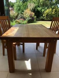 Solid oak extending dining table with 4 chairs seats up to 8