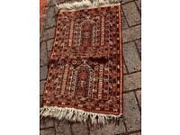 Small rusty brown prayer rug