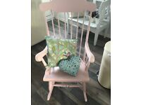Solid wood rocking chair primed the sprayed in pink chalk paint then waxed giving a hard finnish