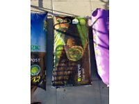 Unopened bags of compost and topsoil