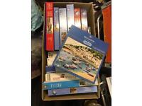 Boxes of jigsaws in good condition.