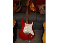 squire stratocaster 6 string electric guitar made by fender, excelent condition