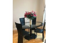 Modern Glass Dining Table with 4 chairs.