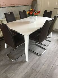 White dinning room table and 6 chairs