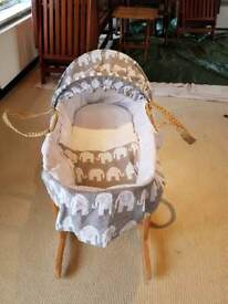 Moses basket complete with mattress hardly used .