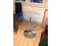 ROUND GLASS DINING TABLE WITH 4 BLACK/SILVER CHAIRS