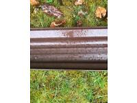 One Length of brown plastic gutter