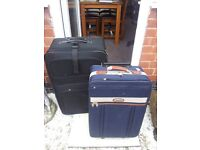 1 LARGE 1 MED SUITCASES EX COND