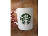 Two Starbucks mugs